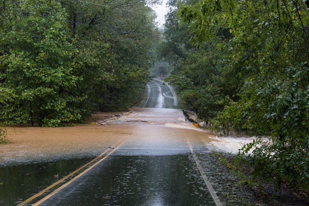 A flooded road can lead to car accidents.